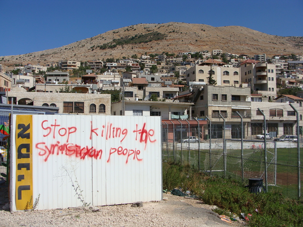 "In Majdal Shams, the largest Arab village, in the occupied Golan Heights, blood red graffiti reads ""Stop killing the Syrian people."" The Golan's Druze, who traditionally supported Syrian President Bashar al-Assad have been divided over the Syrian conf"