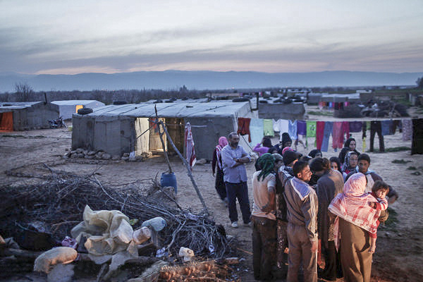 Syrian refugees have taken shelter at a makeshift tent camp set up for Syrian seasonal laborers in Al Qaa, Lebanon