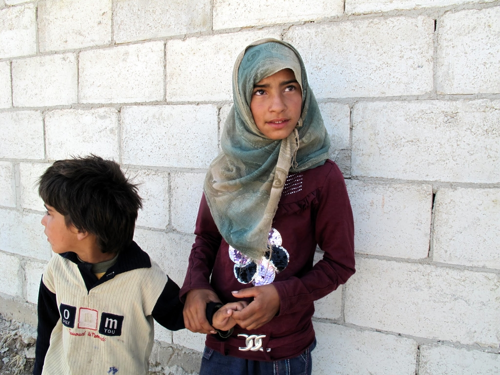 A brother and sister at a food distribution (by WFP and the Syrian Arab Red Crescent) in Qazhal town, northwest of Homs City, in Syria