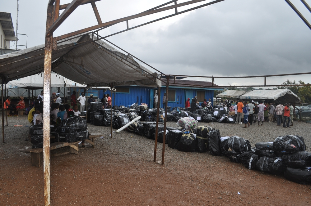 Liberian ex-refugees who have been living in Buduburam camp outside of Accra for years, lost their refugee status in July 2012. 1,000 will return home this year. Ex-refugees line up to weigh their luggage before leaving for Liberia on a UNMIL flight in Se