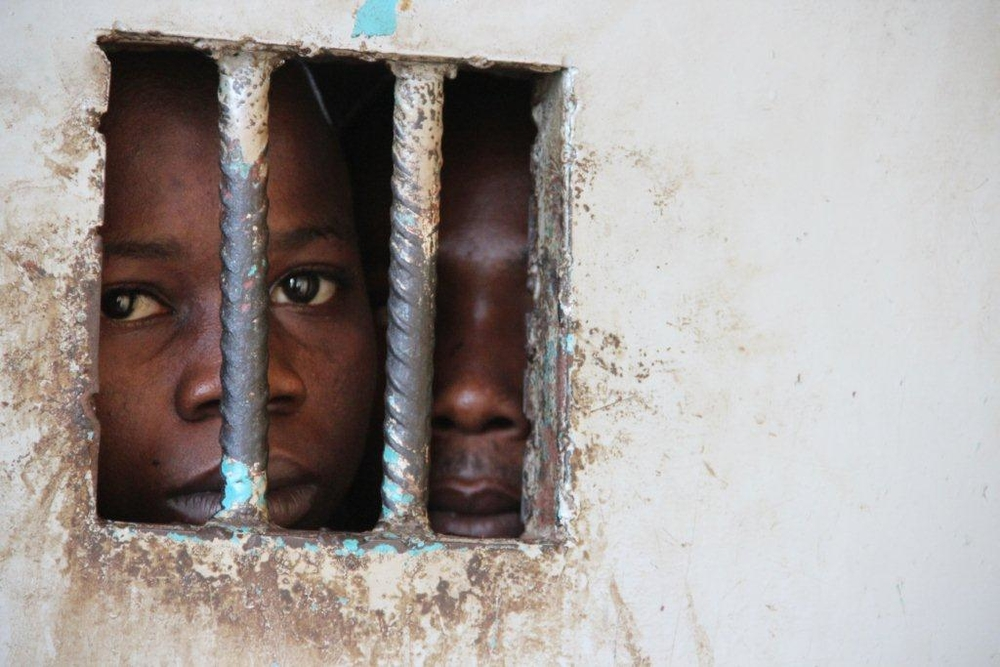 Juveniles in a police cell in a Sierra Leone, where women are being detained for owing debt