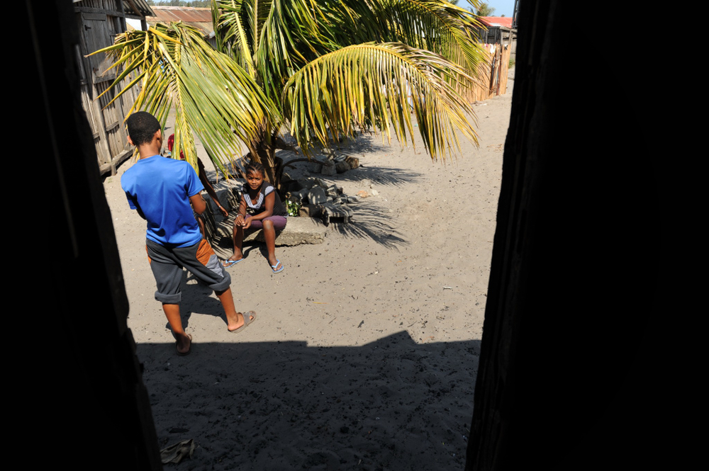 Sitting under the shade of palm tree in Madagascar's south eastern port town of Taolagnaro in the Anbounato  neighbourhood