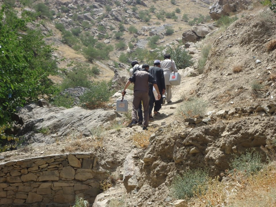 Health teams try to reach children in remote areas of Afghanistan during a polio and measles vaccination campaign in July 2012