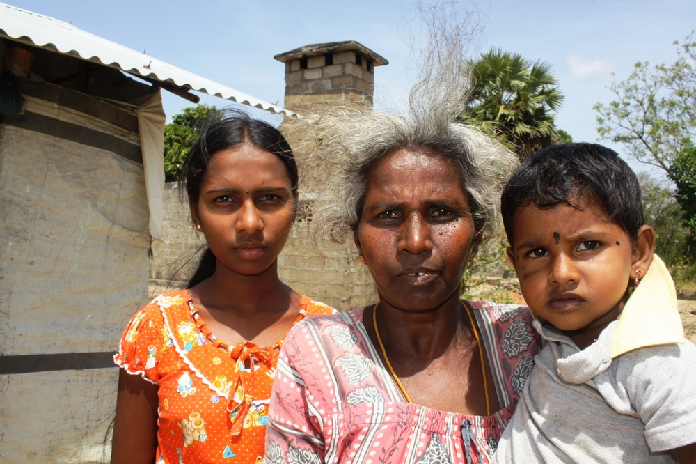 Thangeswary Karuppaiyah, 55, has lived in transitional housing since 2009. The grandmother and recent returnee to Kilinochchi District now wants to rebuild the house behind her