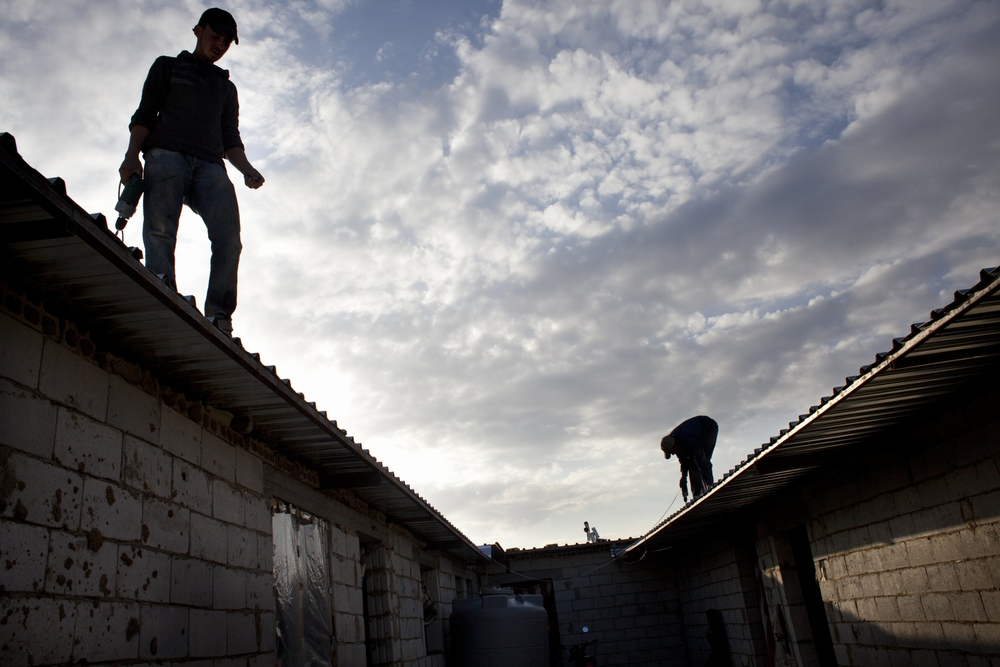 Cement block t-shelters for Syrian refugees being constructed with help from the Danish Refugee Council, UNHCR's partner in Lebanon,  near a mosque in the town of Aarsal, in Lebanon's Bekaa Valley, Nov 6, 2012.