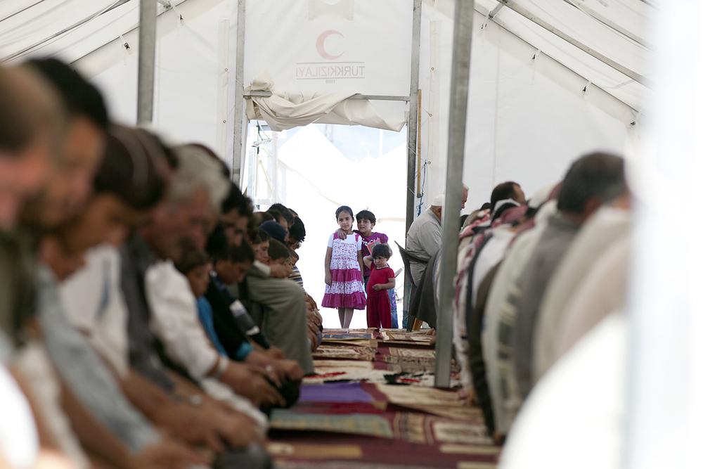 Syrian refugee children at a tent used as a mosque at the Islahiye refugee camp in Hatay, Turkey. (July 2012)