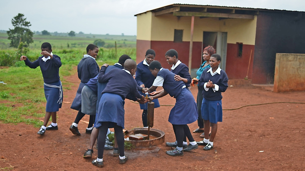 Children wash their hands at Tikhuba High School in Swaziland's eastern Lubombo District