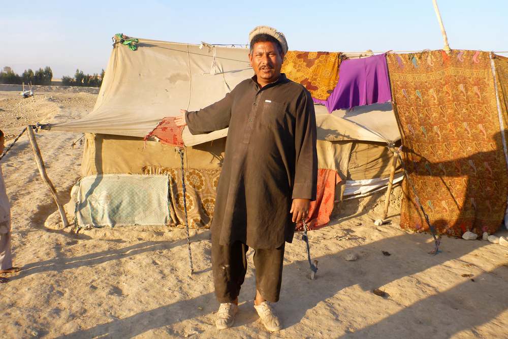An internally displaced person (IDP) shows his living conditions on the outskirts of Jalalabad, Afghanistan (Jan 2013)
