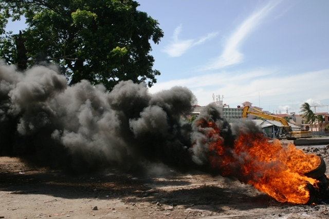 Tyres burn during a protest by residents from Phnom Penh's Boeung Kak lake area. Forced evictions are a major problem in the area