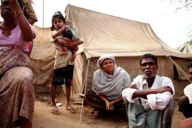 A Rohingya IDP and his family outside his tent in western Rakhine State. More than 125,000 Rohingyas were displaced in June and October 2012 following inter-communal violence in Myanmar's western Rakhine State