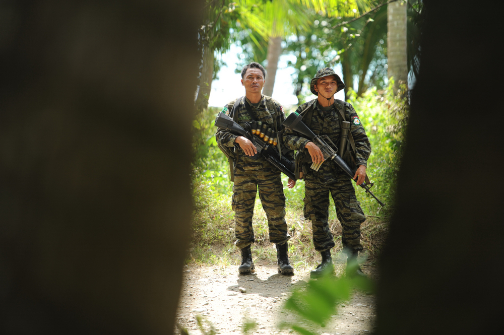 Bangsamoro Islamic Armed Forces (BIAF) combatants, the armed wing of the Philippine Moro Islamic Liberation Front (MILF), near Camp Salahuddin, a fishing village in the Tarragona district of Davao Oriental province on the Philippine island of Mindanao tha