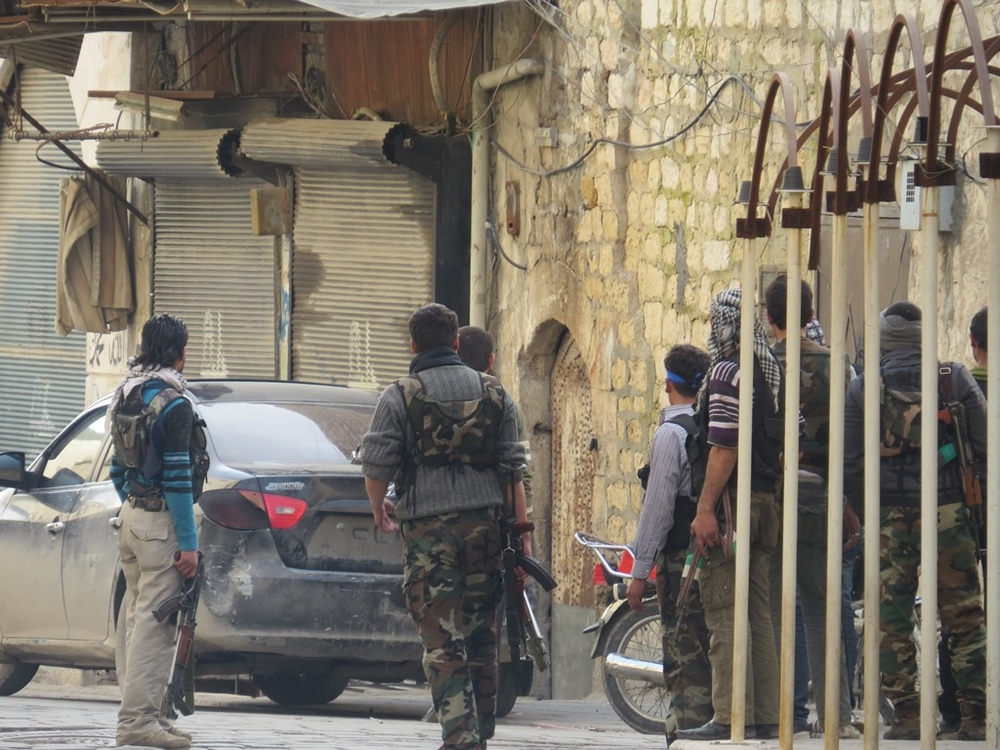 Free Syrian Army fighters in the Old City of Aleppo prepare an attack on Syrian government forces