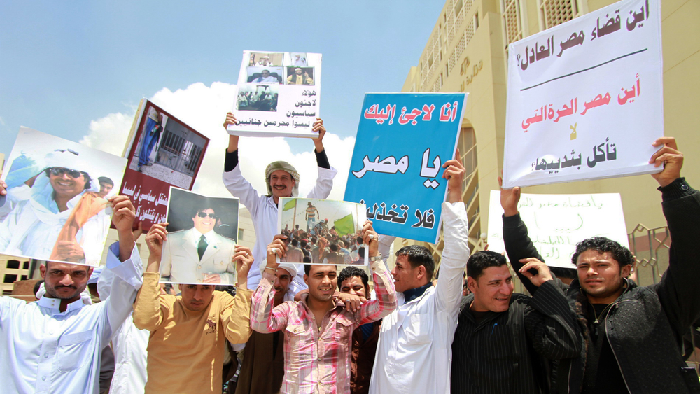 Libyan refugees in Egypt protest outside a court building in New Cairo at plans to export a senior pro-Gaddafi official (March 2013)