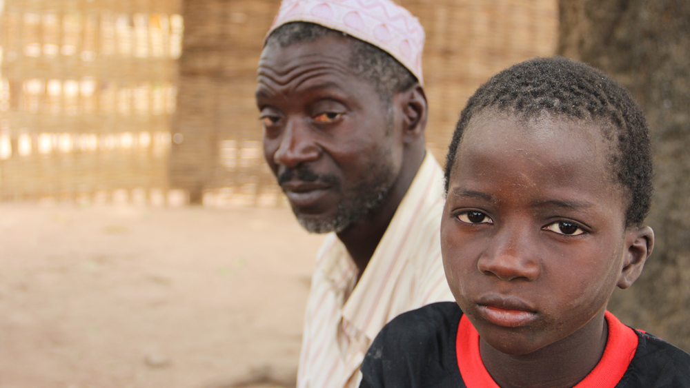 Yaya Djau looks on his son who returned home from a Senegalese Koranic school. Local leaders in his region have called for better protection of children in Koranic schools