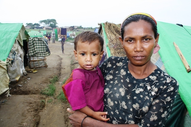 A Rohingya woman and her child look to the camera at a makeshift camp outside Sittwe in Myanmar's western Rakhine State in May 2013. An estimated 140,000 people were displaced following sectarian violence in 2012, the vast majority Rohingya Muslims