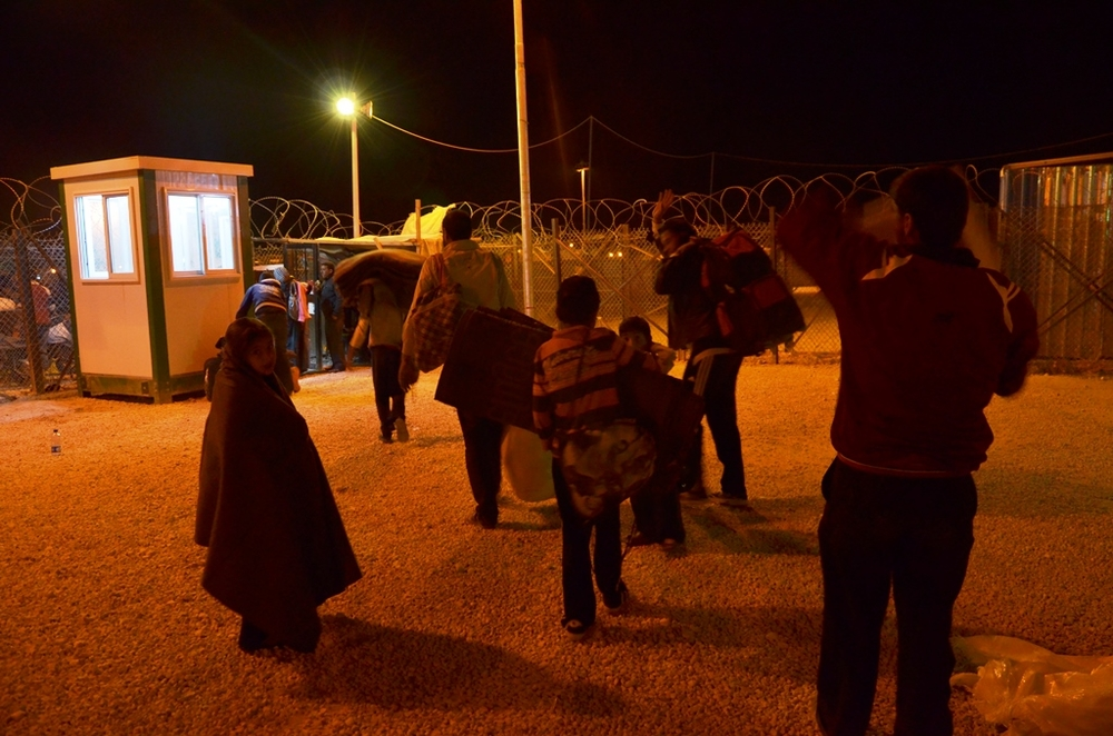 Syrian refugees enter Za'atari camp in northern Jordan in the middle of the night after a long journey to cross the border
