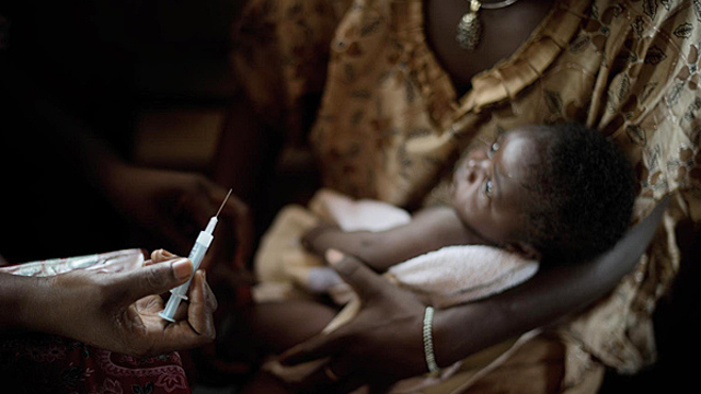 Central African Republic, 2011: A health worker prepares to vaccinate a baby boy in a clinic in Bangui