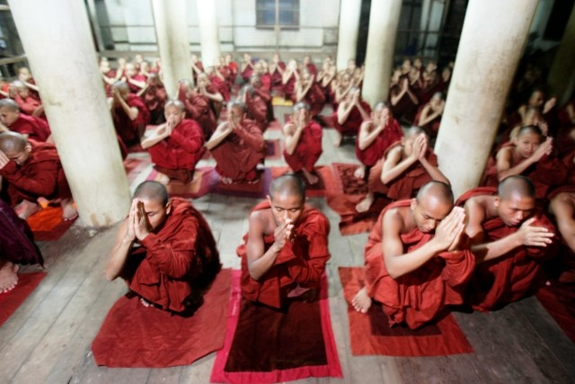 Buddhist monks gather for prayers at a Yangon temple