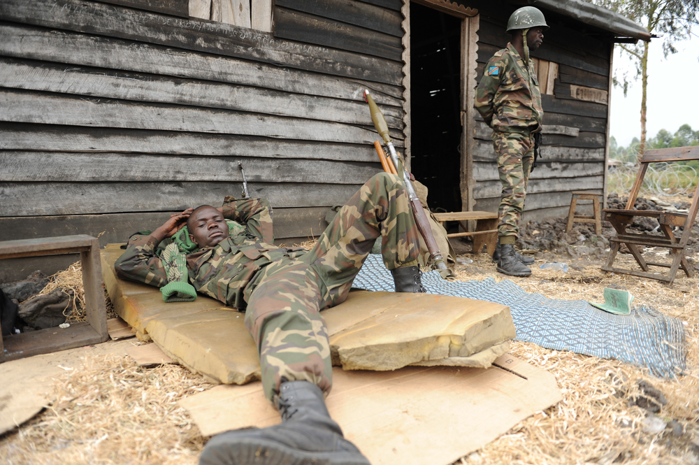 An FARDC soldier rests on the frontline in Kanyaruchinya on the outskirts of the eastern DRC city of Goma during a lull in the fighting with the armed group M23