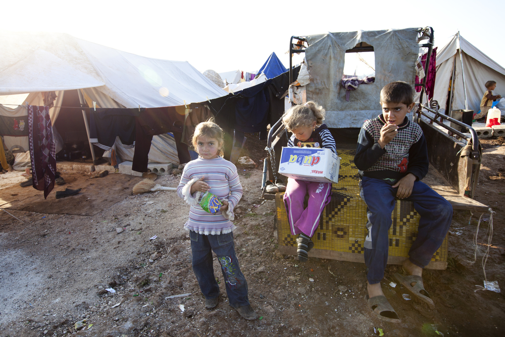 Children at Atme camp for displaced people in northern Syria, near the border with Turkey. Delivery of aid in rebel-held northern Syria is complicated by many factors, and often lacking