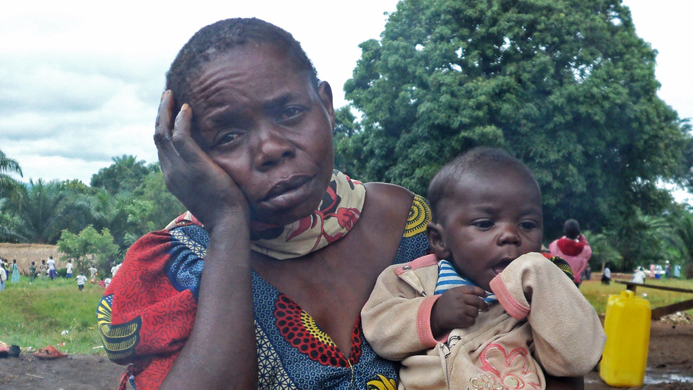 Mathotine  Dz'dai, with her orphaned grand daughter, who recently fled clashes in the northeast DRC town of Bavi, in Ituri district