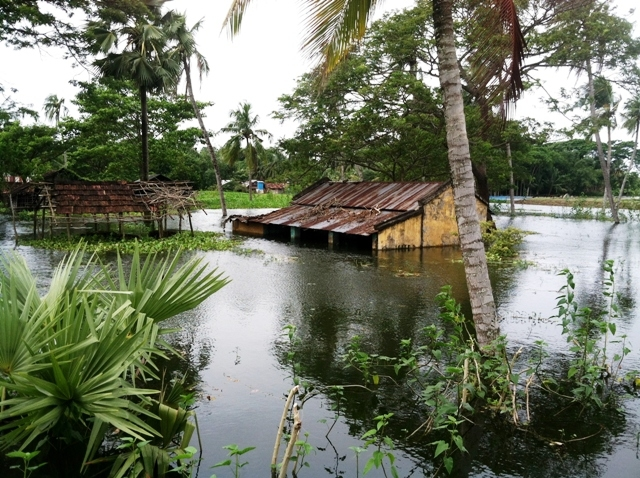 A home submerged by water-logging in Satkhira District. Water-logging - prolonged stagnant flooding - continues to have a major impact on the lives of thousands of residents in southwest Bangladesh