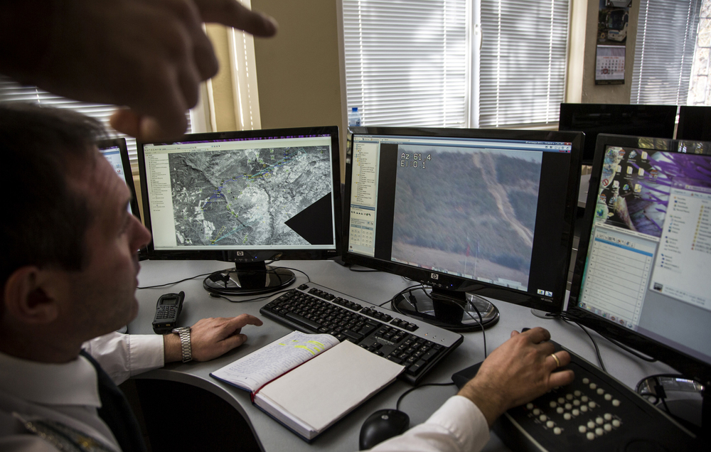 Daniel Dechev, director of surveillance for the Bulgarian border patrol demonstrates how an integrated system of sensors and cameras helps detect irregular border crossings, enabling police to apprehend people. Greece's completion of a new border fence al