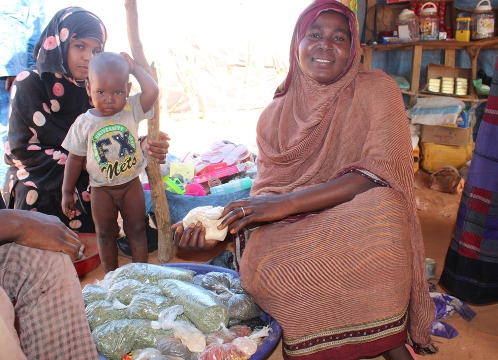 Malian refugees have started setting up boutiques selling basics - food, soap, condiments, even clothes - around Mbera camp in eastern Mauritania. October 2013