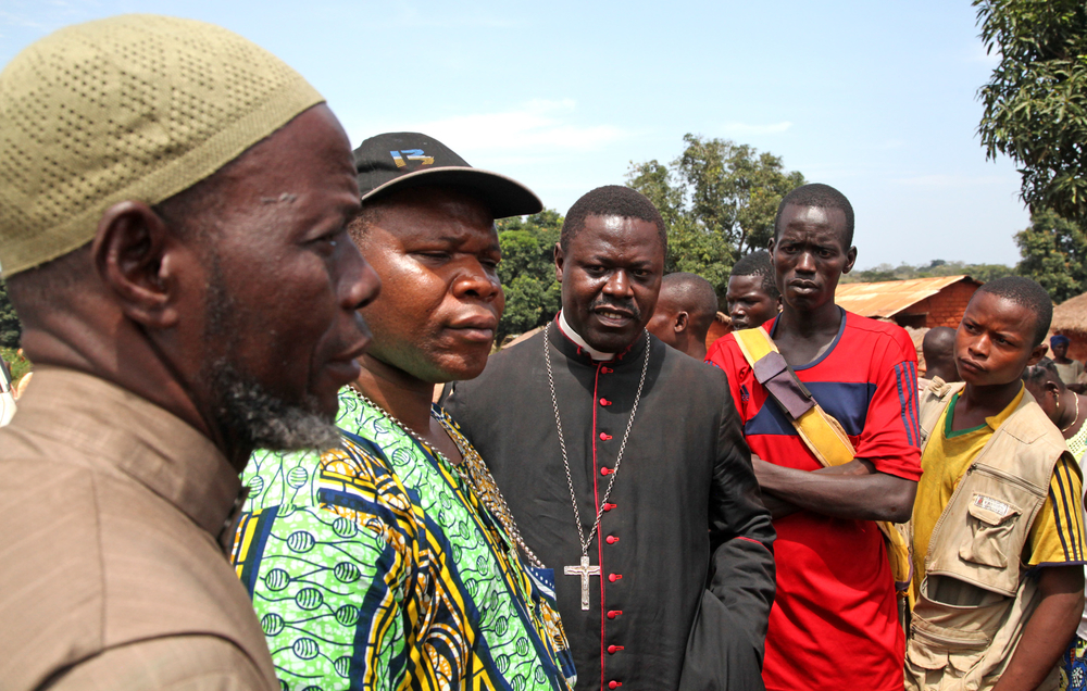 CAR's top Imam Oumar-Kobine Layama (L), Archbishop Dieudonne Nzapalainga (M) and Bishop of Bossangoa Nestor Aziagba (R) listen to tales of woe from communities on the road from Bossangoa to
