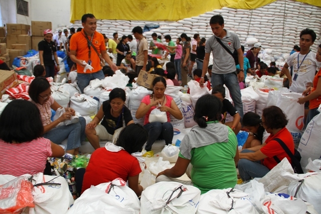 Local aid workers have worked tirelessly for hours in repacking goods for the thousands of affected families in Tacloban City in the aftermath of Typhoon Haiyan, which struck the central Philippines on 8 November 2013