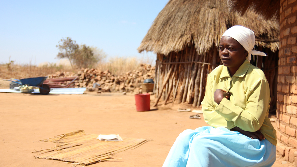 Amai Wadzanai Moyo sits outside her new home soon after being relocated from her village in south-eastern Zimbabwe's Masvingo Province to make way for construction of the Tokwe-Mukosi Dam
