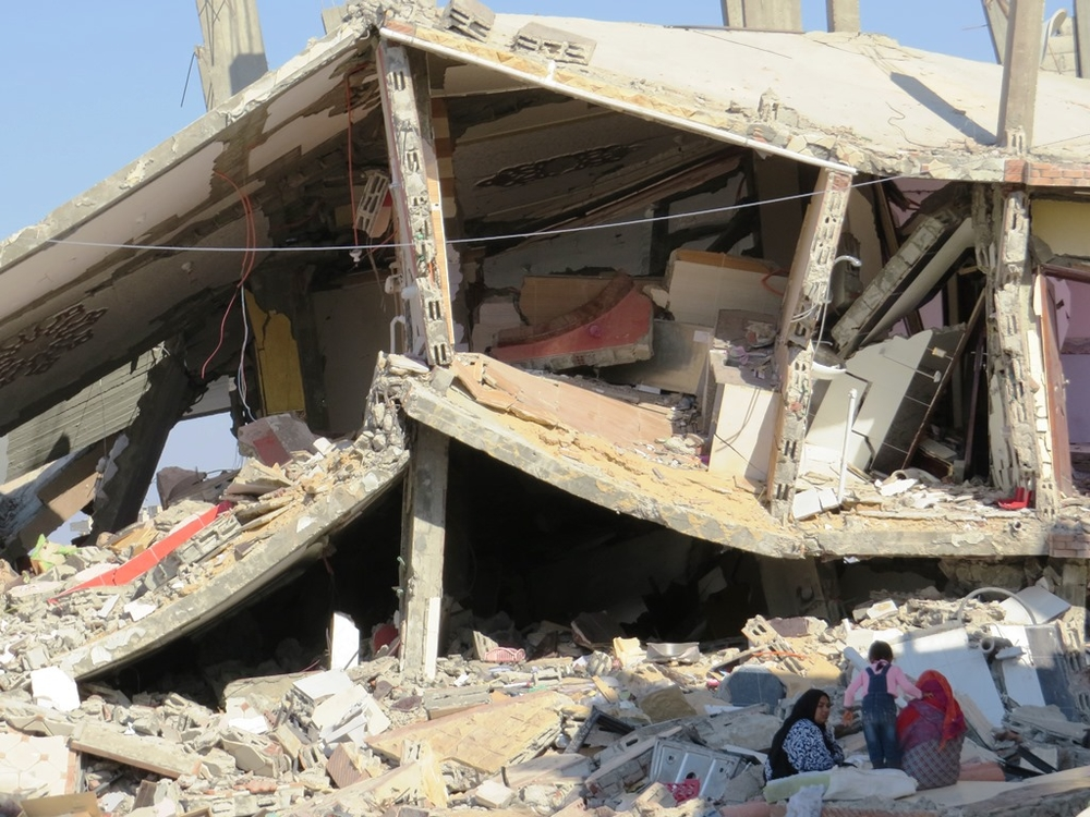 Women and a child sit in the shade amid the rubble of a home in Rafah town in Egypt's North Sinai governorate. The building was destroyed in October during the security forces' counter-terrorism campaign against militants. (Photo taken by Sophie Anmuth in