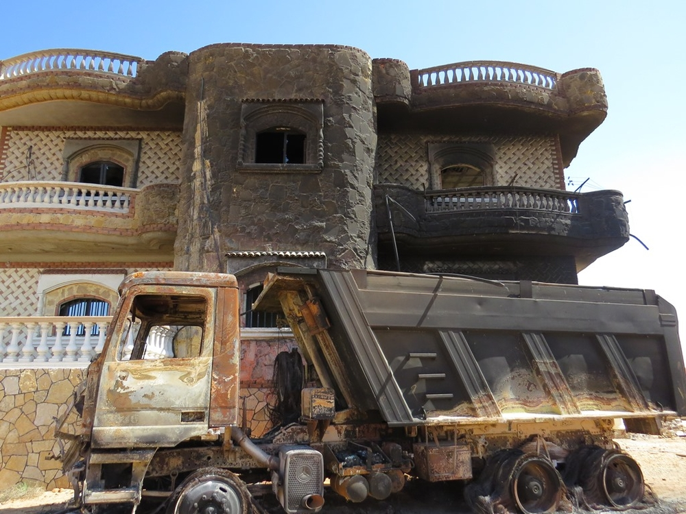 The home of an affluent Bedouin family in al-Mehdiya village, North Sinai. According to the family, the Egyptian army torched the home, several vehicles, a tractor and a generator on the basis that the family was involved in terrorist or smuggling operati