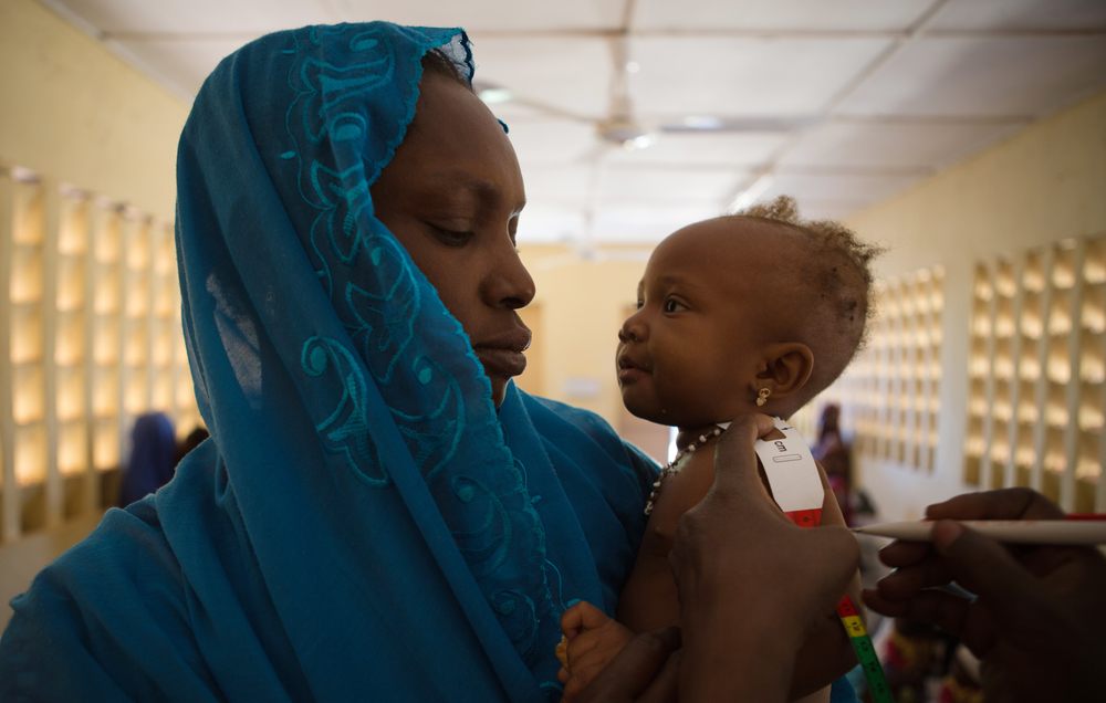 A baby gets her health and weight measured during a consultation at the referral health center in Gao, Mali.  WFP, in partnership with Action Contre la Faim (ACF), provide consultations, care and medication to malnourished children and pregnant women in G