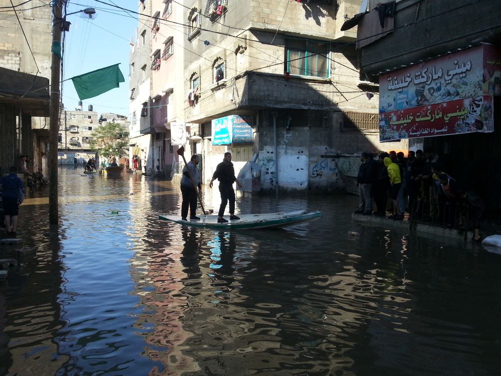 Crews use boats to rescue people stranded by flood waters in Gaza City's Zeitoun area after heavy rains from 11-15 December 2013. (Photo taken on 15 December)