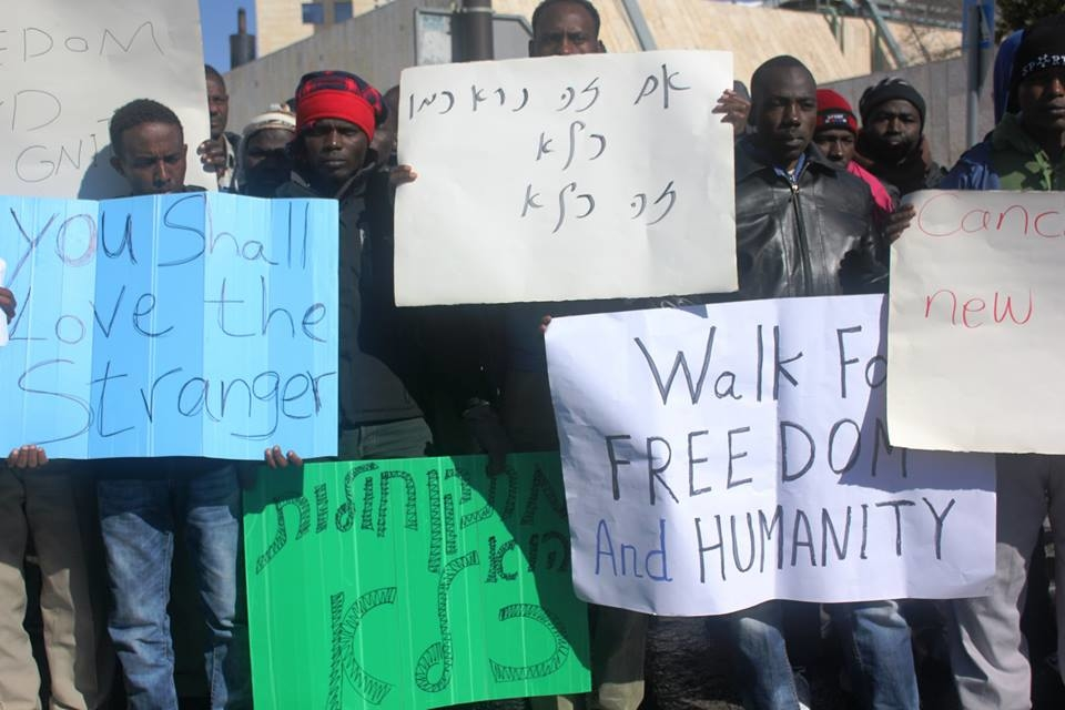 "African asylum seekers demonstrating outside Israel's parliament in Jerusalem shortly before being arrested and returned to a new ""open"" holding facility in the southern Negev desert"