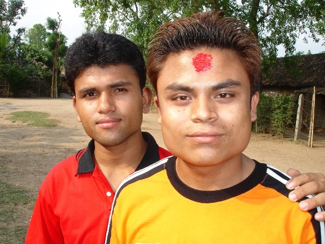 Two Bhutanese young men look to the camera at a refugee camp in eastern Nepal. Since late 2007, more than 86,000 Bhutanese refugees have received third country resettlement