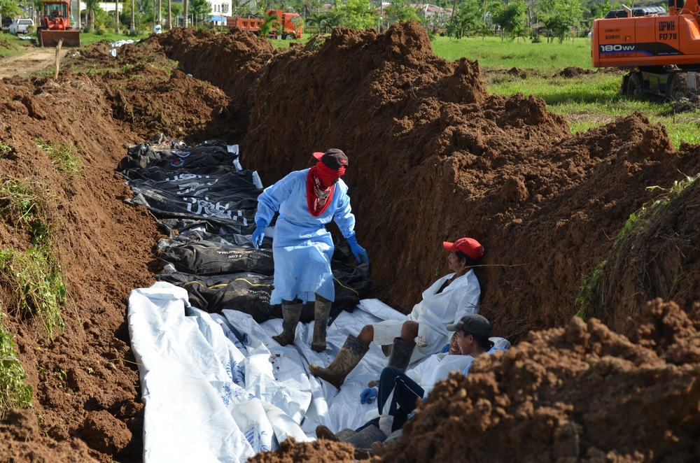 Burial of unclaimed cadavers following the Philippines' Typhoon Haiyan took place some two months after the typhoon hit