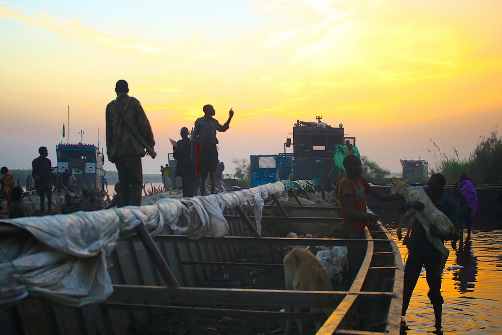 People arrive at dawn to Awerial settlement fleeing the conflict in and around the town Bor. Those who make the treacherous journey are being charged extortionate fees to cross the river Nile to safety, often spiralling into debt to afford the fare. An es