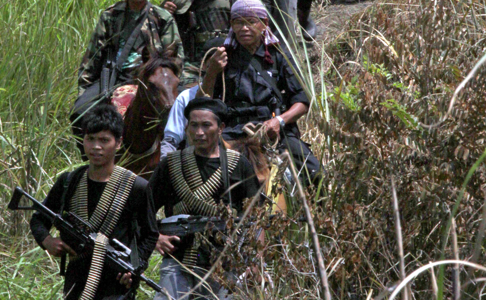 Bangsamoro Islamic Freedom Fighters (BIFF)chief Ameril Umbrakato (on horseback) leads his men in a mountain hideout in the southern province of Maguindanao (2011)