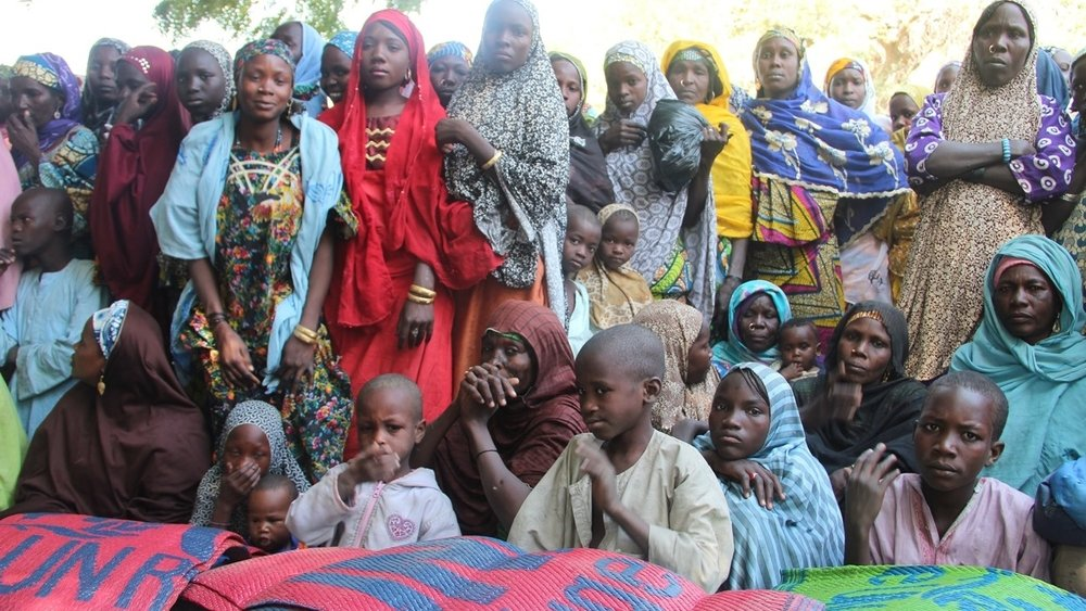 Displaced and host families in Gasseré village on the border of Niger and Nigeria, wait for non-food items to be distributed by UNHCR on 26 January. Their village, Gashakar, in Borno State, was attacked by Boko Haram militants on 18 January, causing 200