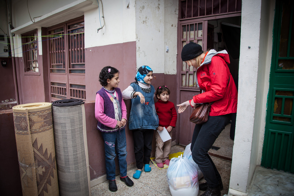 NGO workers distribute aid to Syrian children in Lebanon.