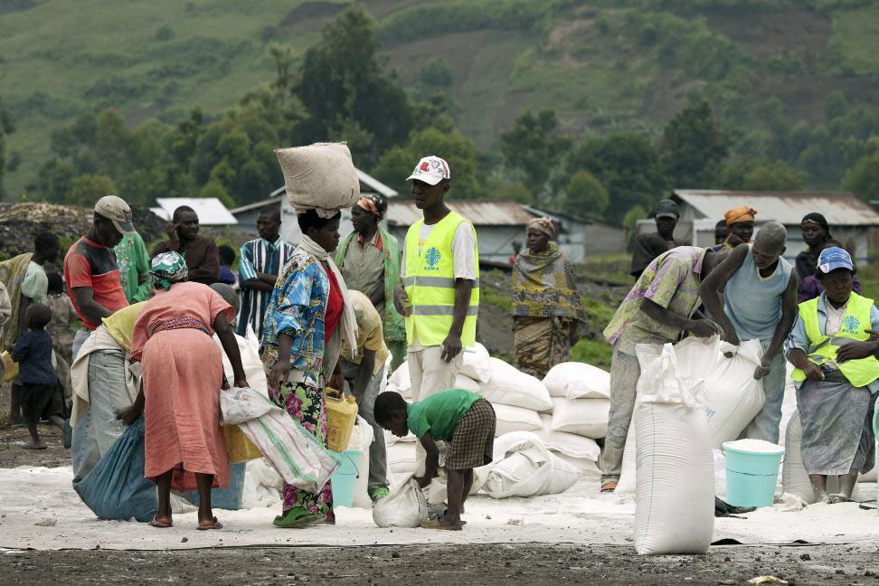 Residents of an IDP camp in North Kivu receive food rations distributed by WFP