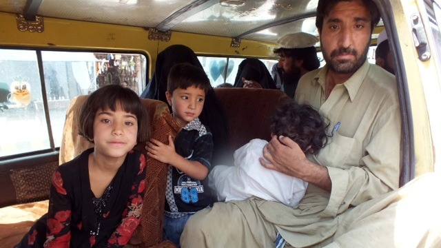 Families from North Waziristan traveling to Bannu. Pakistani security forces have setup checkpoints along the road.
