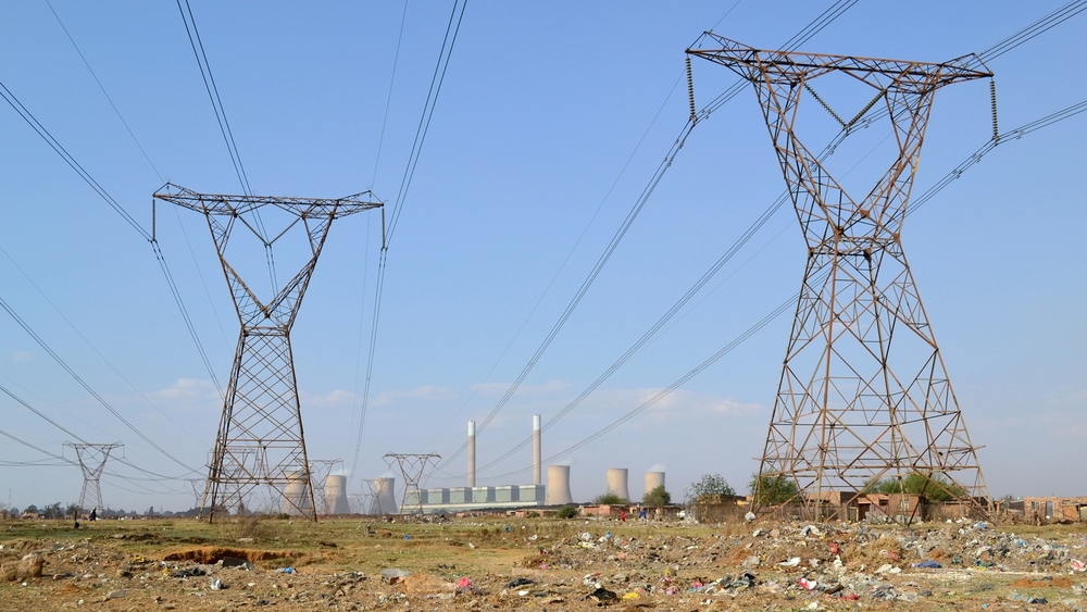A view of Duvha Power Station from Masakhane informal settlement in South Africa's Mpumalanga Province. Despite their proximity to the power station, residents lack electricity and must rely on burning coal to cook and heat their homes.