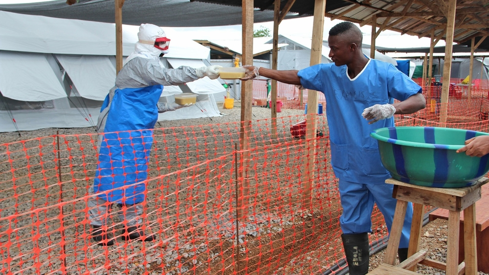 Health workers at the IFRC Ebola treatment centre outside of Kenema serve staff breakfast: WFP-provided CSB. (October 2014)