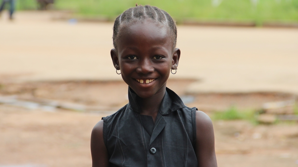 An out of school girl in Kenema, Sierra Leone. All schools are closed until further notice in Sierra Leone because of the Ebola outbreak.