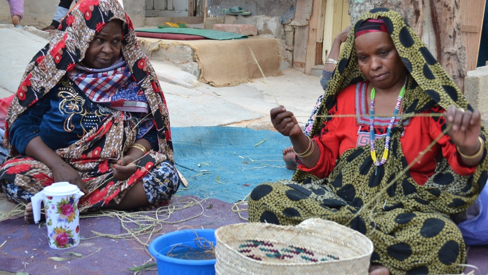 Tawergha women handcrafting traditional bak to be sold in the souks near the airport in Tripoli, Libya.