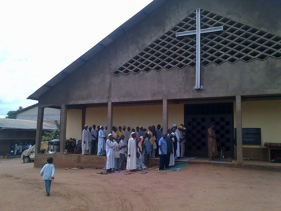 Muslims pray in front of the catholic church of Carnot, in Central African Republic