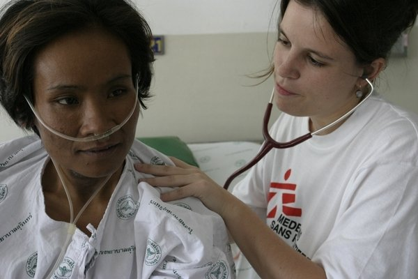 An MSF employee tends to a patient in Thailand